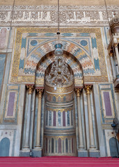 Colorful decorated marble wall with engraved Mihrab (niche) at the Mosque and Madrassa (School) of Sultan Hassan, Cairo, Egypt
