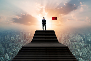 Success and effort man concept, business people  in suit standing with winner flag and looking over cityscape view and thinking business plan of the future