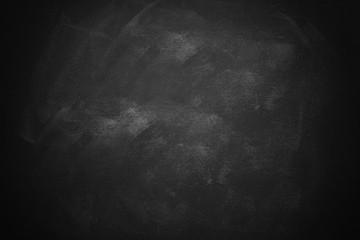 black and dark chalkboard or blackboard wall texture background