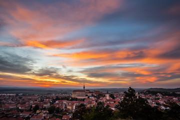 Colorful autumn Sunset over the Mikulov city, Moravia, Czech Republic