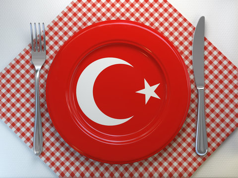 Turkish cuisine  or turkish restaurant concept. Plate with flag ofTurkey with knife and fork.