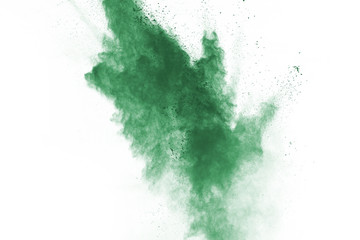 Green powder explosion on white background. Colored cloud. Colorful dust explode. Paint Holi.