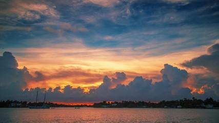 Fotobehang - Beautiful sunset clouds over ocean water in Miami, Florida. Timelapse, 4K UHD.