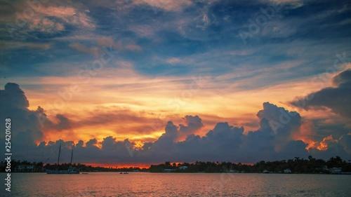 Fotobehang Beautiful sunset clouds over ocean water in Miami, Florida. Timelapse, 4K UHD.