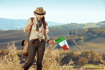 active tourist woman with Italian flag looking down