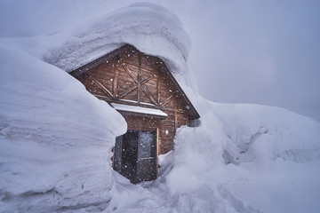 Wooden house at Hakkoda ropeway in Mount Tamoyachi with snowy time at Aomori, Japan.