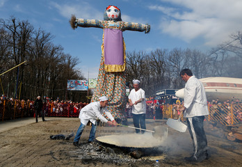 Chefs prepare a 2-meter pancake during celebration of Maslenitsa, also known as Pancake Week, which is a pagan holiday marking the end of winter in Stavropol