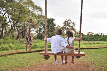 Wall Mural - siblings on swing