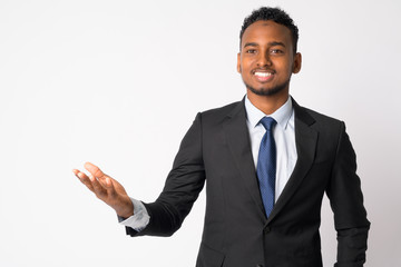 Happy young handsome African businessman showing something