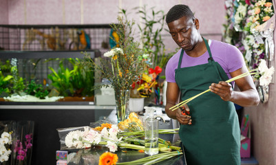 Florist preparing gerberas for bouquet