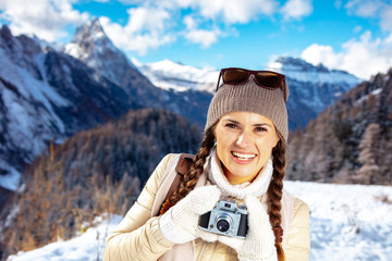 traveller woman with retro photo camera in Alto Adige, Italy