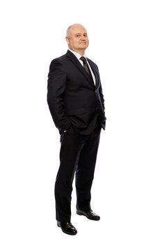 Bald middle-aged man in a suit, full-length, isolated on white background. Vertical.