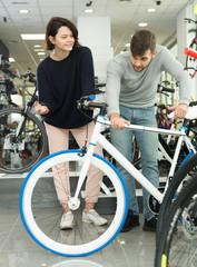 pair buying sport bicycle