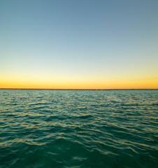 sunset in Lagoon of Seven Colors in Bacalar,Quintana Roo, México.