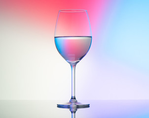 wine glasses dishes on a colored background