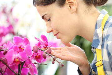 woman smells the flowers in the garden, fragrance of orchids
