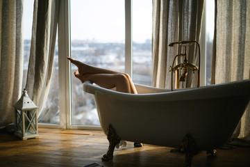 Woman take a bath in the bathroom.