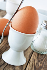 Boiled egg and egg cup with spoon
