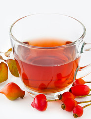 Rose hip tea and glass cup with fruits
