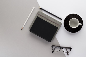 pencil notepad glasses coffee cub top view with copy space for your text. flat lay.