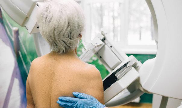 Senior woman having a mammography scan at hospital