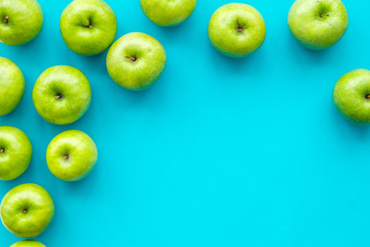 food pattern with green apples on blue background top view space for text