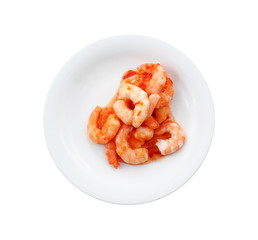 Portion of shrimps with chili sauce on plate