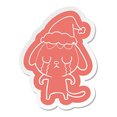 cute cartoon  sticker of a dog crying wearing santa hat