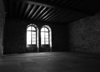 daylight throug windows in empty old building dark room