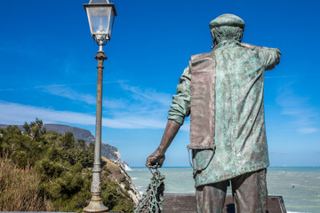 Statue of fisherman and Mount Conero - Numana Sirolo Ancona Marche Italy
