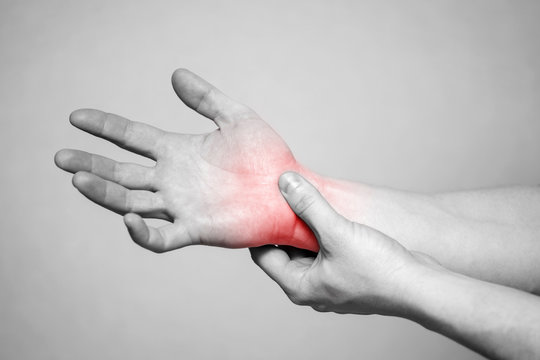 Pain in the joints of the hands. Carpal tunnel syndrome. Hand injury, feeling pain. Health care and medical concept