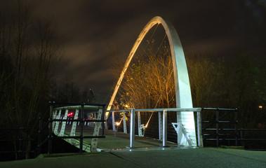 whitehall bridge a pedestrian footbridge crossing the river aire in leeds illuminated at night