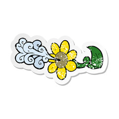 retro distressed sticker of a cartoon flower squirting water