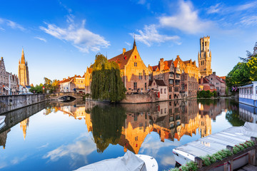 Stores photo Bruges Bruges, Belgium. The Rozenhoedkaai canal in Bruges with the Belfry in the background.