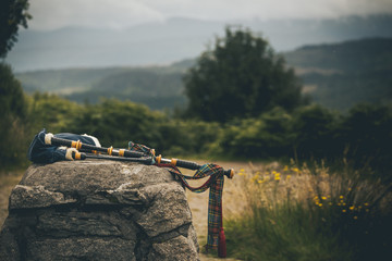 isolated bagpipes in scotland highlands laying on a rock in middle of summer great illustration of scottish culture Wall mural