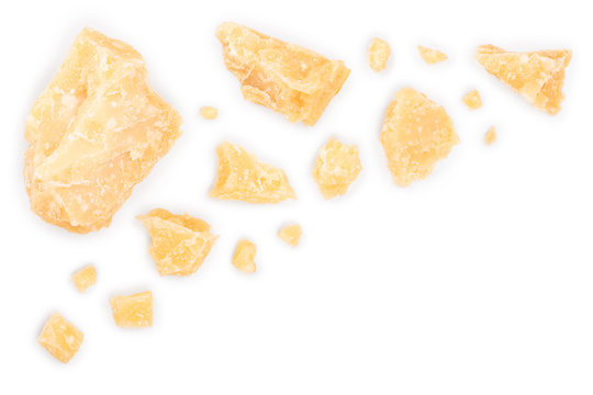 Parmesan cheese pieces isolated on white background with copy space for your text. Closeup. Top view. Flat lay