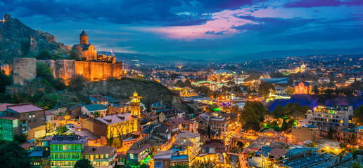 Panoramic view of Tbilisi, Georgia after sunset Fototapete
