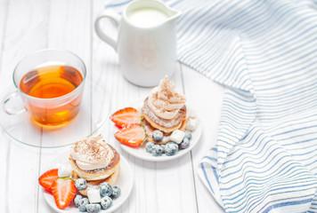 Healthy breakfast, black tea and  homemade pancakes with fresh berries