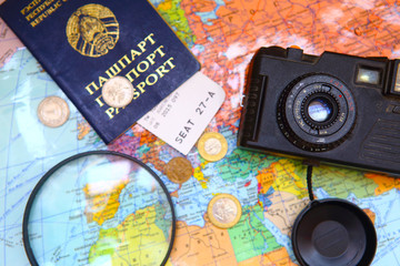 Money, passport and camera on the map. Preparation for the travel