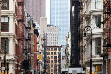 Crowded old buildings at the intersection of Broome and Greene Streets in SoHo New York City
