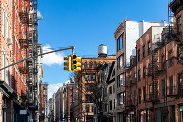 Historic buildings along Spring Street on a bright sunny day in Manhattan, New York City NYC