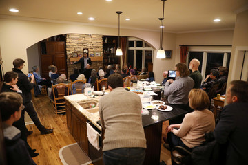 U.S. 2020 Democratic presidential candidate Andrew Yang speaks at Potluck Insurgency, a local democratic activist event, at the home of one of its members in Iowa City, Iowa
