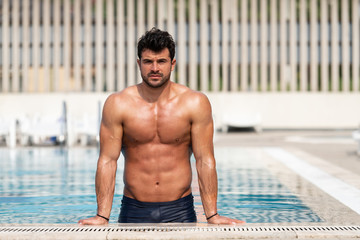 Young Muscular Man At Swimming Outdoor Pool