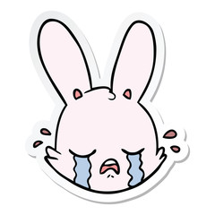 sticker of a cartoon crying bunny face