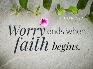 Worry ends when faith begins with bible verse design for Christianity with sandy beach background.