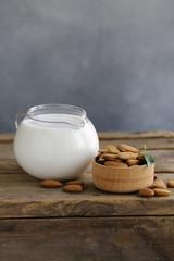 almond milk on a wooden table