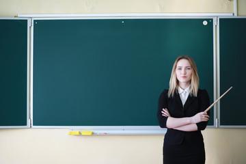 Young girl teacher in primary school