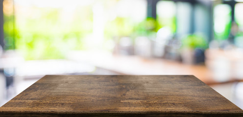 Empty perspective hard wood table and blurred garden cafe light background. product display template.Business presentation.