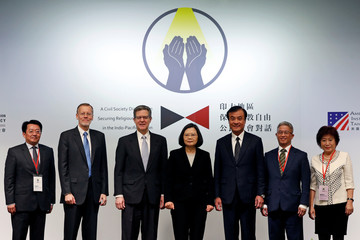 "U.S. Ambassador for religious freedom, Sam Brownback and Taiwan President Tsai Ing-wen pose for group photo before ""A Civil Society Dialogue on Securing Religious Freedom in the Indo-Pacific Region"" forum in Taipei"