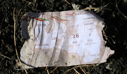 A boarding pass is seen at the scene of the Ethiopian Airlines Flight ET 302 plane crash, near the town of Bishoftu, southeast of Addis Ababa